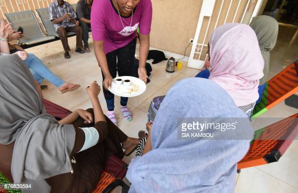 A refugee serves tea to visitors at a UNHCR building in Niamey on November 17 after being evacuated from Libya France will be the first to welcome...