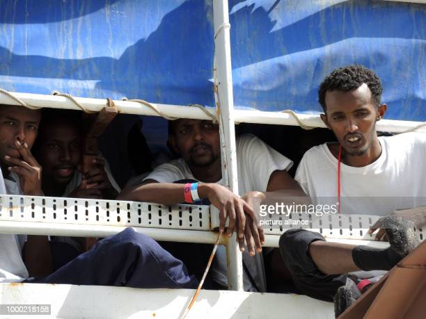 A refugee sits on the rescue ship 'Aquarius' in the Mediterranean Sea 29 June 2017 The humanitarian aid organisation Doctors without borders and SOS...