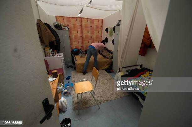 A refugee straightens his bed at the refugee accommodation in Esslingen Germany 11 February 2015 Aroun 105 young men from Syria and Gambia are being...
