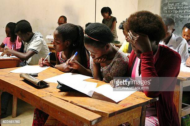 Refugee students attend a class on September 6 at the Kiziba camp in western Rwanda Created at the beginning of the First Congo War the camp hosts...