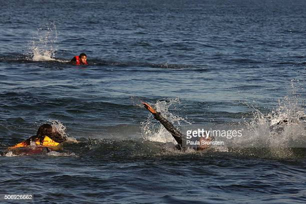 A refugee swims to Greek shores after jumping out of the overcrowded raft he was in heading to Lesbos Greece on October 262015 Winter seas have done...