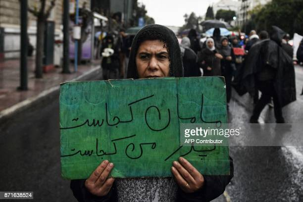 A refugee takes part in a march towards the German embassy in Athens on November 8 to demand a faster family reunification process in Germany...