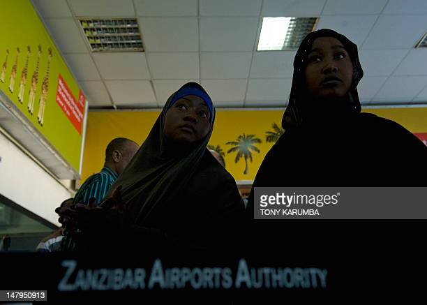 Refugee wait to be processed by immigration officers at Zanzibar's Abeid amani Karume airport on July 6 after being repatriated from Somalia's...