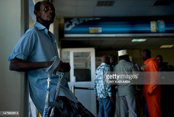 A refugee waits to be processed by immigration officers at Zanzibar's Abeid amani Karume airport on July 6 after being repatriated from Somalia's...