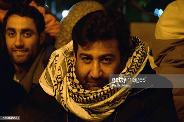 Refugee wears a Palestinian scarf for protection against the cold. Syrian refugees that live in Greece stay outside the Greek parliament in Syntagma...