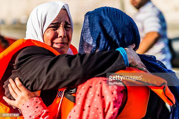 Refugee woman crying on 30th August 2015 in Kos Greece Kos on the brink as Mediterranean refugee crisis continues with many boats arriving each night...