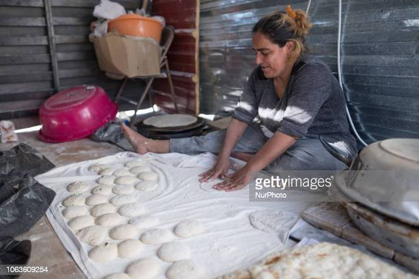 Refugee woman makes naan a kind of a flatbread in Diavata Anagnostopoulou refugee camp near Thessaloniki in Greece Refugees prefer to create their...