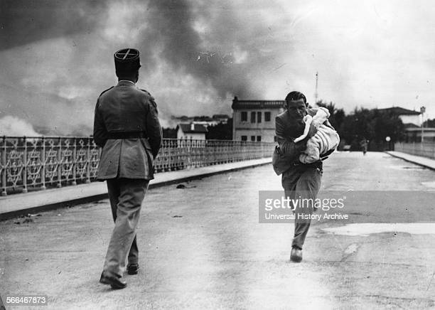 Refugee woman runs towards the Spanish French border during the Spanish Civil War