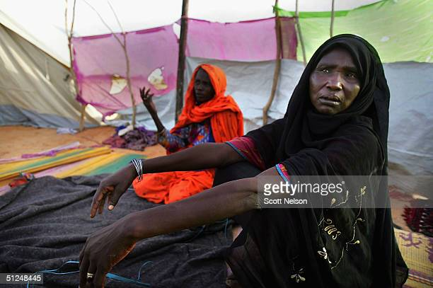 Refugee women from the Darfur region of Sudan discuss their situation outside their tent home in the Oure Cassoni refugee camp on August 31 2004 in...