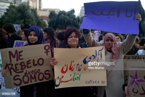 Refugee women hold banners during a rally for International Women's Day on March 8 2018 in Athens Greece Women around the world attended events...