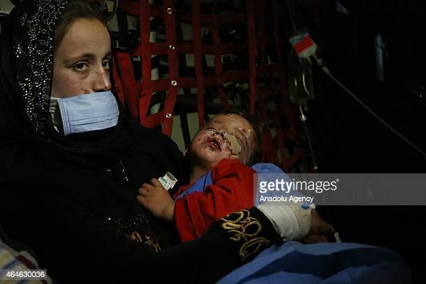 A refugee women hold his baby inside a military plane who carried Iraqi Interior Minister Muhammad Salim alGabbani at al Asad Airbase after alGabbani...