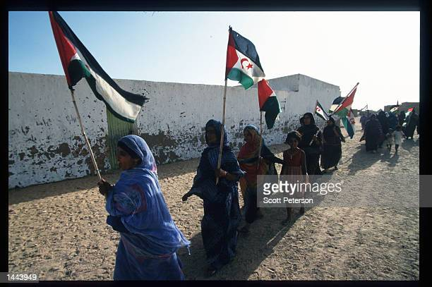 Refugee women prepare Polisario flags for a commemoration celebration of call for Western Sahara independence June 18 1997 in Algeria Since 1976...