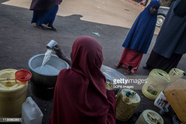 Refugee women seen selling camel milk in the refugee camp. Dadaab is one of the largest refugee camps in the world. More than 200,000 refugees live...
