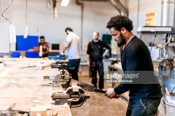 A Refugee works at arrivo excercise workshop of Berlin chamber of crafts on October 30 2017 in Berlin Germany