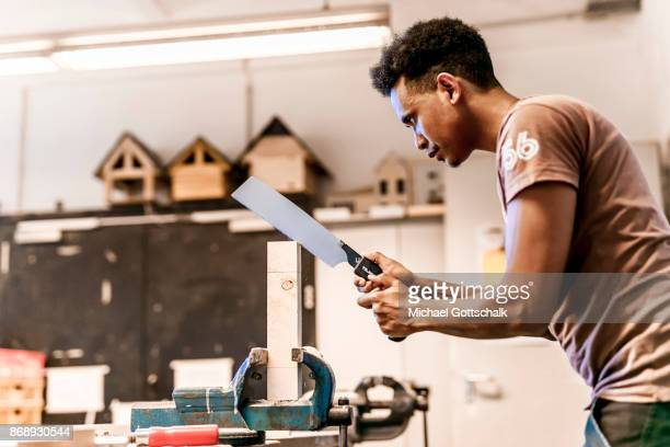 A Refugee works at arrivo excercise workshop of Berlin chamber of crafts on October 01 2017 in Berlin Germany