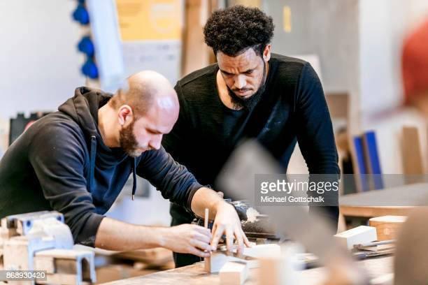 A Refugee works next to his trainer at arrivo excercise workshop of Berlin chamber of crafts on October 30 2017 in Berlin Germany