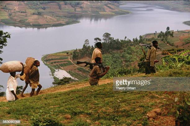 Refugees and a soldier in the foothills of Lake Kivu The whole of this series of images takes place along the route between Gisenyi and Ruhengeri in...
