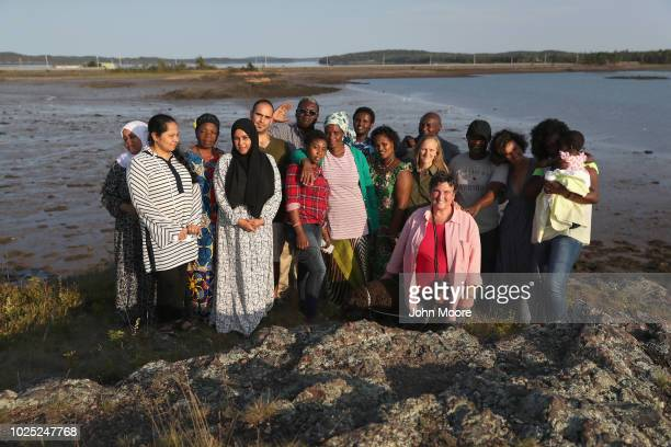 Refugees and asylum seekers from Malaysia Sri Lanka Congo Iraq Somalia Kenya and Zambia pose for photos with instructors at the Native American...