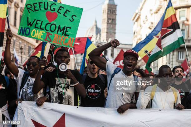 Refugees and asylum seekers march downtown during the 'Non è reato' national demonstration to protest against racism and to ask justice and equality...