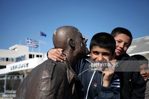 Refugees and immigrants find shelter at the former Athens International Airport, Elliniko, in Athens on Mar 19, 2016. The airport closed in 2001 and...