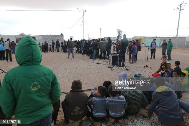 Refugees and journalists are seen as Special envoy of the UN refugee agency and movie star Angelina Jolie holds a press conference at the Zaatari...