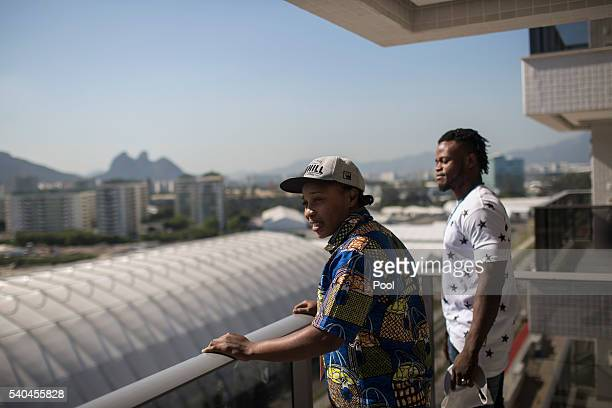 Refugees and judo athletes from the Democratic Republic of Congo Yolande Mabika, center, and Popole Misenga, right, take in the view from their...
