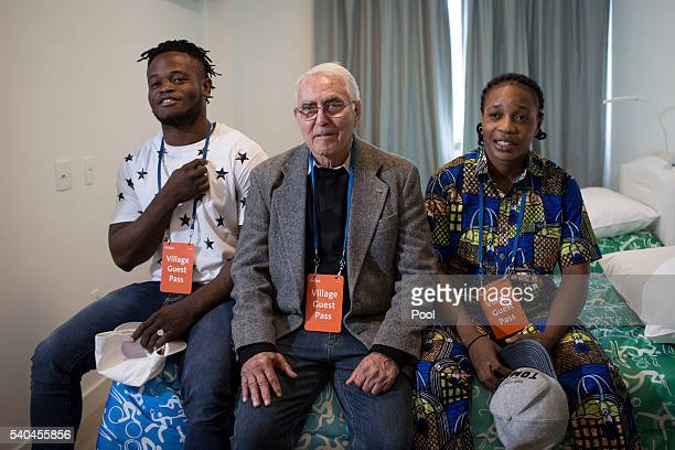 Refugees and judo athletes from the Democratic Republic of Congo Yolande Mabika, right, and Popole Misenga pose for a photo with their coach Geraldo...