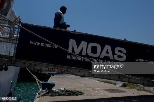 Refugees and migrants are seen disembarking the Migrant Offshore Aid Station 'Phoenix' vessel on May 27 2017 in Crotone Italy The refugees and...