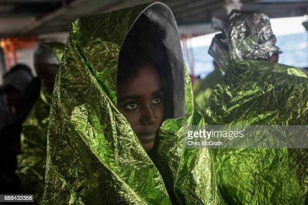 Refugees and migrants are seen on board the Migrant Offshore Aid Station 'Phoenix' vessel on May 25 2017 off Lampedusa Italy The crew of the...