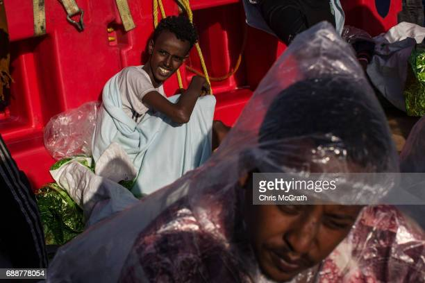 Refugees and migrants are seen on board the Migrant Offshore Aid Station 'Phoenix' vessel on May 26 2017 off Crotone Italy The refugees and migrants...