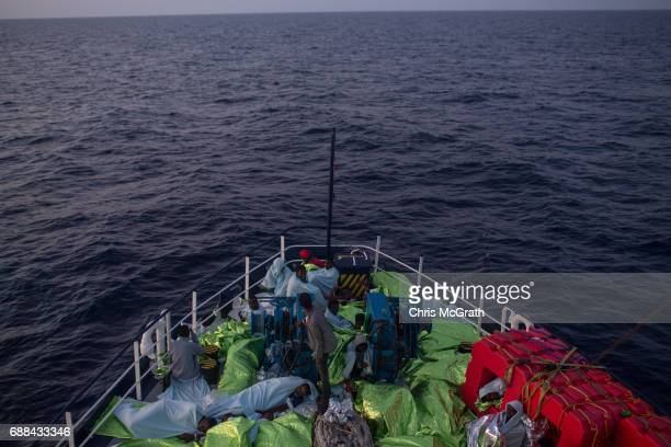 Refugees and migrants are seen sleeping on board the Migrant Offshore Aid Station Phoenix vessel on May 25 2017 off Lampedusa Italy The crew of the...