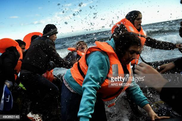 Refugees and migrants arrive at the Greek island of Lesbos after crossing the Aegean sea from Turkey on October 1 2015 UN SecretaryGeneral Ban Kimoon...