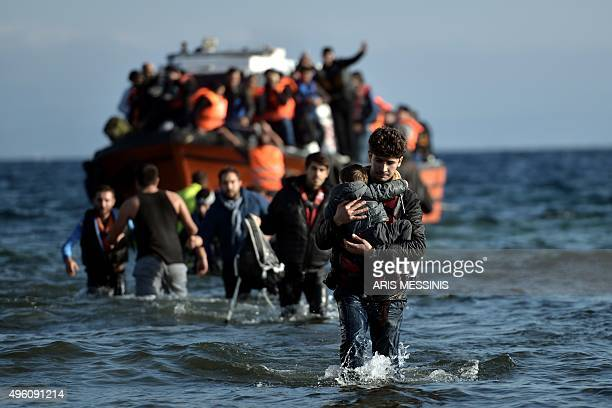 Refugees and migrants arrive on the Greek Lesbos island after crossing the Aegean Sea from Turkey on November 7 2015 Nearly 500 people have died...