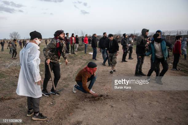 Refugees and migrants clash with Greek border guards along the border fence at Pazarkulke Border crossing on on March 07, 2020 in Edirne, Turkey....