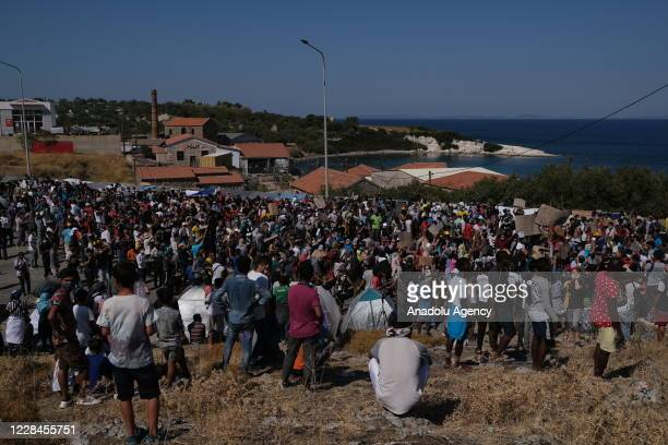 Refugees and migrants from the Moria camp protest the living conditions in the camp as they become homeless after a fire destroyed the Moria refugee...