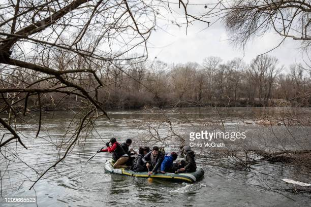 Refugees and migrants from various countries board a boat in an attempt to reach Greece from Turkey by crossing the Evros River on March 01 2020 in...