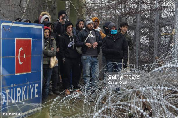Refugees and migrants gather at Pazarkule border as they attempt to enter Greece from Turkey on February 29 2020 in Edirne Turkey Turkey announced...