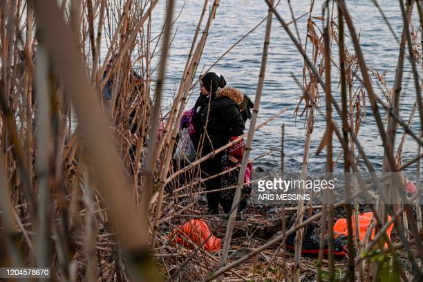 Refugees and migrants land ashore the Greek island of Lesbos on March 2 2020 Around 500 migrants landed on Sunday morning in around 10 vessels...