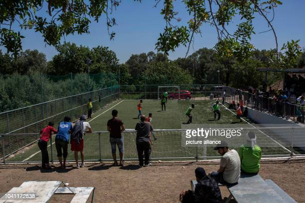 Refugees and migrants playing in front of the Vial refugee camp on the island of Chios Greece 27 April 2017 Some 3700 refugees and migrants are...