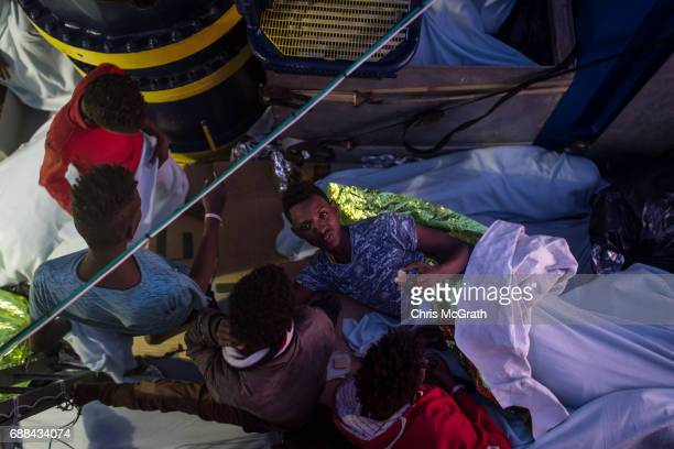 Refugees and migrants try to rest on board the Migrant Offshore Aid Station 'Phoenix' vessel on May 25 2017 off Lampedusa Italy The crew of the...