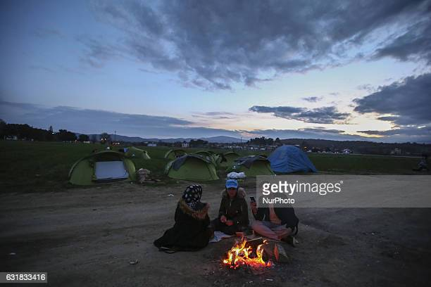Refugees and migrants try to warm themselves through fires in the makeshift camp in Idomeni Greece February 2016 They use everything to sustain the...