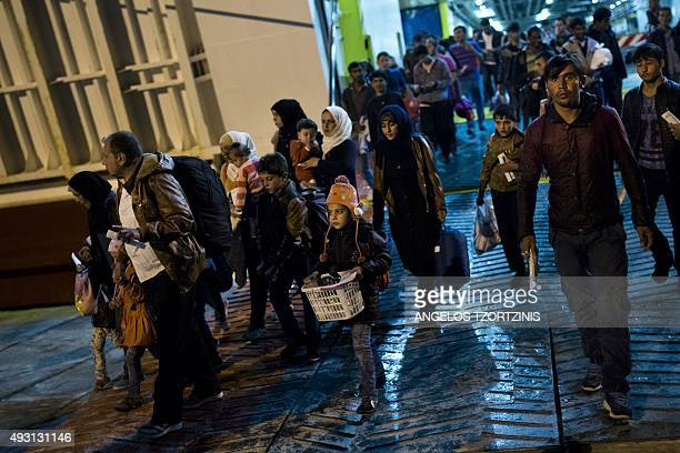 Refugees and migrants unload the 'Eleftherios Venizelos' ferry boat chartered by the Greek government in the port of Piraeus on October 17 2015...