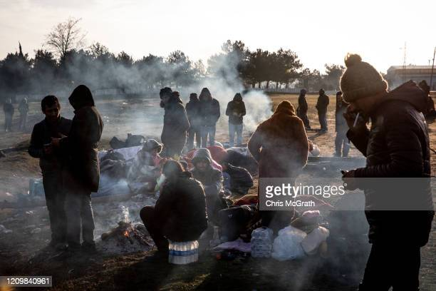 Refugees and migrants wait in camps on the Turkish shoreline of the Evros River while they wait to cross by boat to Greece on March 02 2020 in Edirne...