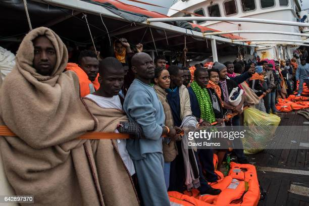 Refugees and migrants wait on deck of the Spanish NGO Proactiva Open Arms rescue vessel Golfo Azzurro to disembark after being rescued off Libyan...
