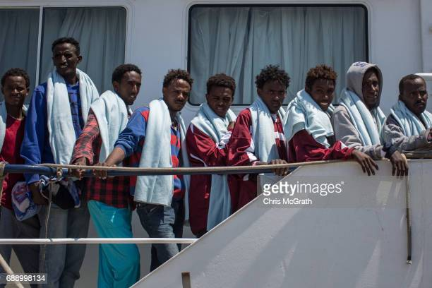Refugees and migrants wait to disembark the Migrant Offshore Aid Station 'Phoenix' vessel on May 27 2017 in Crotone Italy The refugees and migrants...