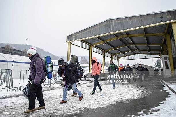 Refugees and migrants walk to cross the SlovenianAustrian border on January 5 2016 in Sentilj / AFP / Rene Gomolj