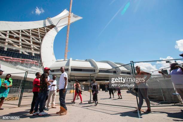 Refugees and some of their Canadians supporters mingle outside Olympic Stadium in Montreal Quebec August 5 2017 The stadium has been turned into a...
