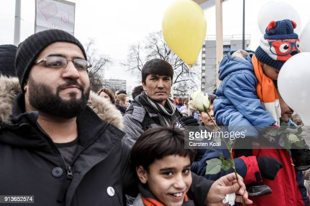 Refugees and supportive locals march under the motto Live Without Hate in the city center to protest for peaceful coexistence on February 3 2018 in...