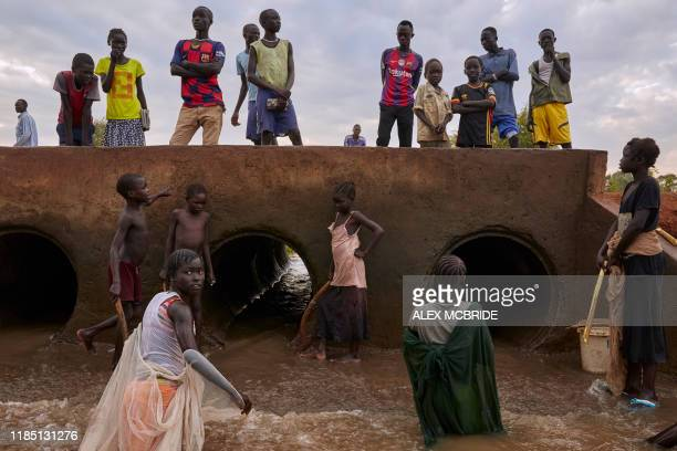 Refugees and the local host community fish together at a stream formed from intense flooding in Maban, South Sudan on Wednesday November 27, 2019. -...