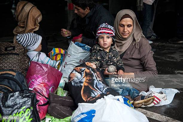 Refugees and their children waiting for a bus that will take them to the Croatian border More and more refugees arrived at Belgrade camp despite of...